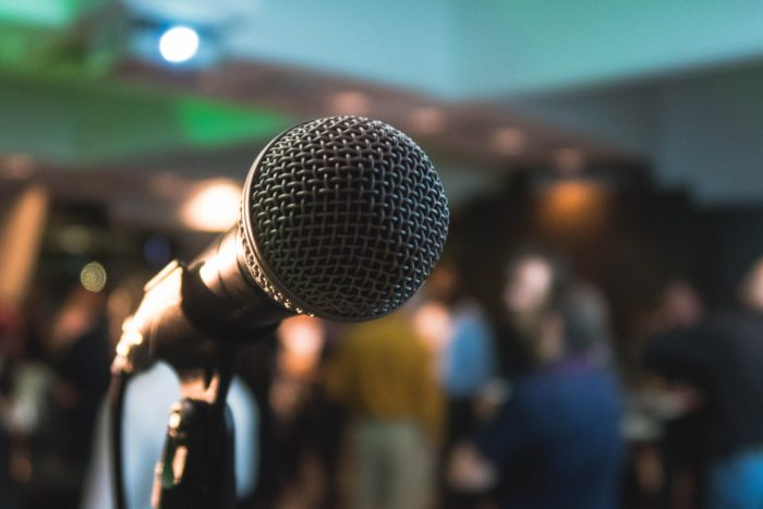 microphone with blurry audience
