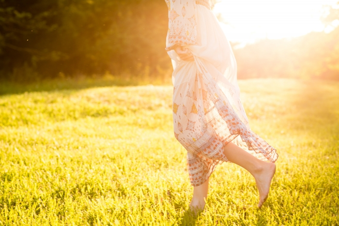 girl in field with sunlight
