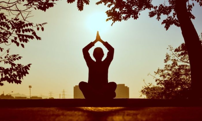 silhouette of a yoga pose outside